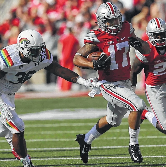 Don Speck | The Lima News Ohio State receiver and punt returner Jalin Marshall (17) heads up the field for a big gain against Hawaii earlier this season. Marshall has since changed his number to 7.