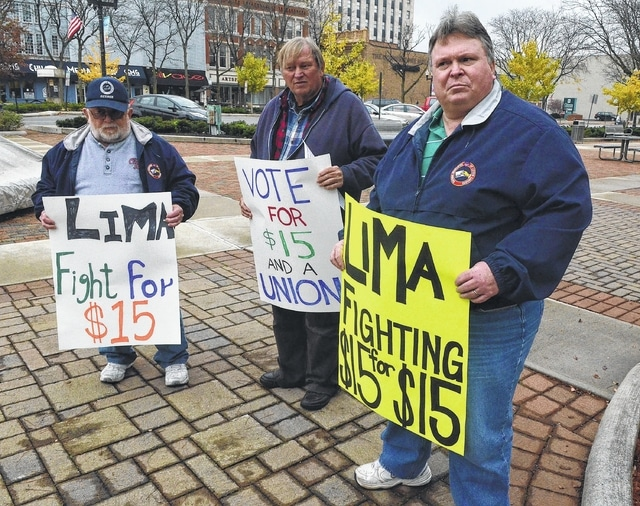 Craig J. Orosz | The Lima News Jim Wilhelm, Fred Brinkman and Tom McNamara, far right, participate in a solidarity protest outside Lima City Hall on Tuesday, pushing for $15 an hour as the new federal minimum wage.