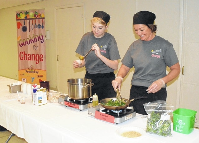 John Bush | The Lima News Apollo culinary student Shelby Dieterich, left, and instructor Carrie Hamilton prepare pumpkin soup at St. Mark on Tuesday as part of the Cooking for Change program.