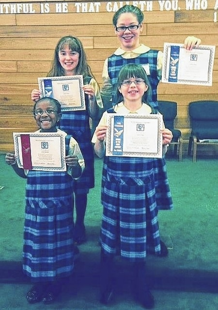 Dave Stratton | Submitted photo Lima Christian Academy students Charis Stump, Lindsey Stump, Giana Rudolph and Sarah Fickel hold up the certificates they received for placing in the Buckeye Christian School Association Elementary Speech Contest.