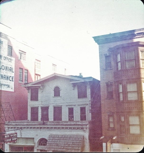 The Colonial Hotel had fallen out of use as a hotel by the 1930s and instead housed businesses, pictured here in the 1980s.