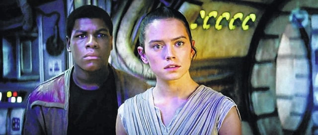 """A screenshot shows a scene from """"Star Wars: The Force Awakens."""" The movie opens Friday."""