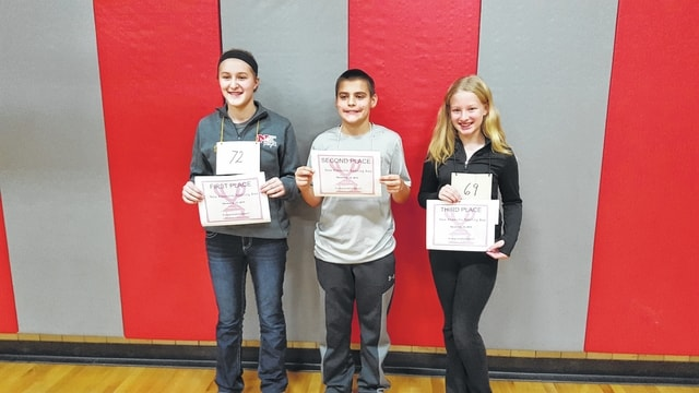 Carly Fledderjohann, left, won the New Knoxville Spelling bee, followed by second-place winner Hunter Fultz and third-place winner Alysha Katterheinrich.