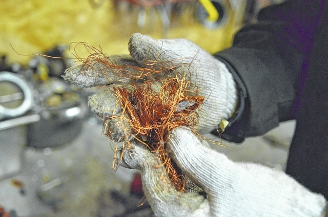 Craig J. Orosz | The Lima News Jose Maldonado holds copper wire taken from an old electric motor.