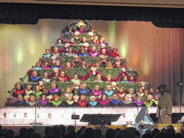 Danae King | The Lima News Choir members perform as part of the Living Christmas Tree in Spencerville.