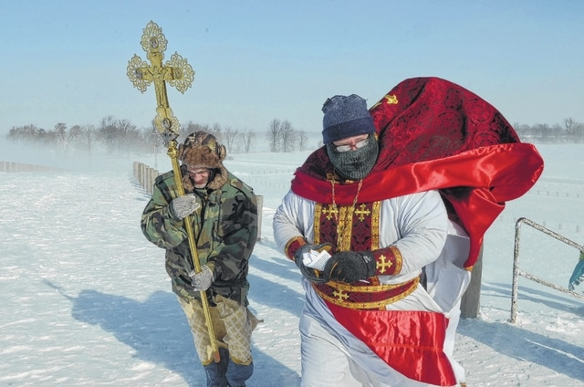 Standing atop Bresler Reservoir, battling with winds bringing temperatures below zero, The Rev. Mark Hodges and members of St. Stephen the First Martyr Orthodox Church blessed the waters two years ago to celebrate Epiphany.
