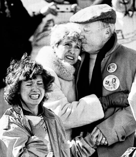 The family of Christa McAuliffe, a teacher who was America's first astronaut, realize the horror after the Space Shuttle orbiter Challenger blew apart after liftoff from Kennedy Space Center, Florida, Tuesday, Jan. 28, 1986. The sister of Christa, Betsy, left, and parents Grace and Ed Corrigan console each other after the explosion. (AP Photo/Jim Cole)