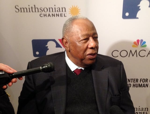 """In this Feb. 5 photo, Atlanta Braves Hall of Famer Hank Aaron speaks in Atlanta. Aaron attended the screening of the film """"The Hammer of Hank Aaron,"""" which will premiere on the Smithsonian Channel on Monday."""