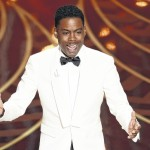 Rock comes out swinging at Oscars, 'Mad Max' revs up