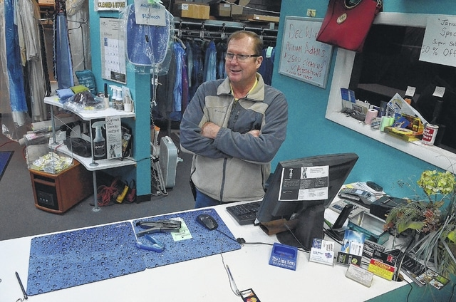 Tim Suever, owner of Advantage Cleaners on Cable Road in Lima, arrives at work at 5:30 a.m. to make sure everything's ready for the 6:30 a.m. business opening.