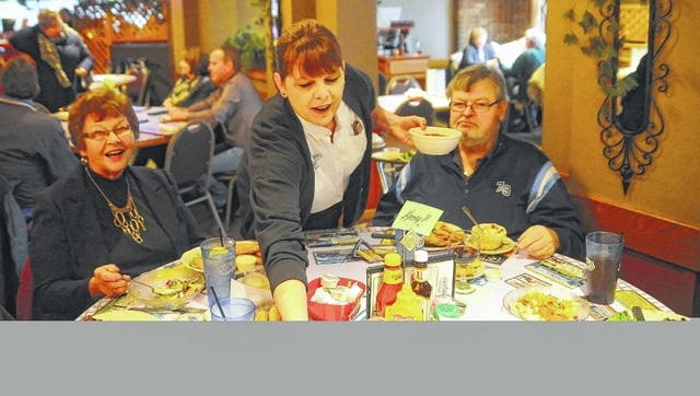 Kathleen Fisher-Payne serves food to customers at Casa Lu Al recently. R