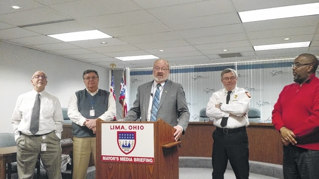 Lima Mayor David Berger speaks during the retirement announcement of utility Director Gary Sheely and Lima Fire Chief Mark Heffner Wednesday in city council chambers. From left: Deputy Utility Director Michael Caprella, Sheely, Berger, Heffner, and Deputy Public Works Director Saul Allen.
