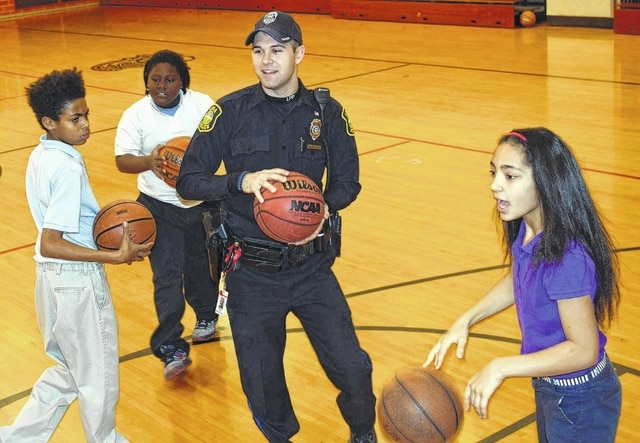 "The use of school resource officers in Lima Schools is one way the Lima Police Department is trying to build trust and possibly get students interested in being a police officer. At North Middle School, students say school resource officer Matt Taylor ""is a good friend. He's like a teacher."" Taylor said working in the schools allows children a chance to police officers as regular people."