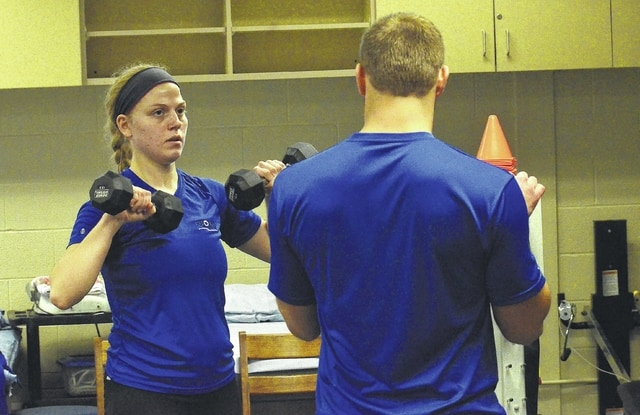 Leah Bihn, left, works out with Tanner Craig during a fitness class at Rhodes State in Lima.