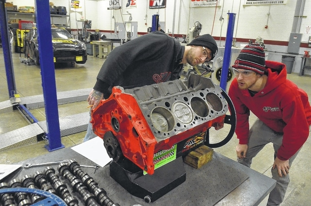 Kevin Kain, left, and his brother, Kyle, from Columbus, set an engine camshaft at UNOH High Performance Motorsports program.