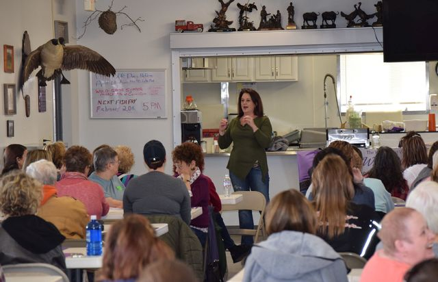 Jen Whitaker talks to nearly 100 women who attended the first Well Armed Woman meeting Sunday at the Cairo Sportsman's Club. The group is just starting in the Lima area and is only for women to learn about guns and gun safety in a women-friendly environment.