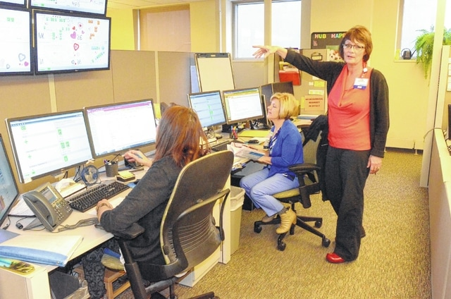Sam Rahrig, director of the patient flow center at St. Rita's Medical Center, points to the computer monitors that help direct where patients are housed in the hospital.
