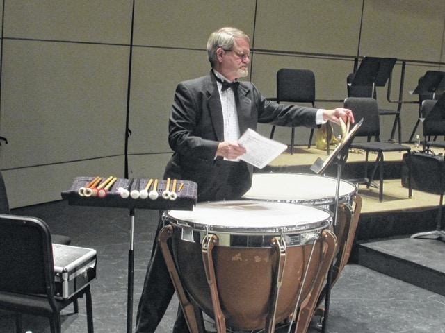 Musical artists use time to tune their instruments and go over the parts prior to every performance with the Lima Symphony Orchestra.