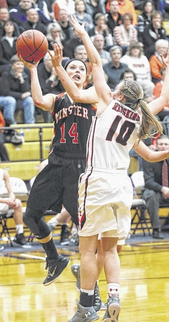 Minster's Rosie Westerbeck tries to shoot over Fort Loramie's Taylor Gasson during Wednesday's regional semifinal at Butler High School in Vandalia.