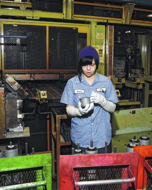 Amanda Hardesty inspect parts on the Sunbaru automated line at DTR in Bluffton.