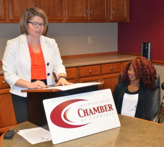 Adah Ellerbrock, director of programs at the Lima/Allen County Chamber of Commerce, announces award finalists during a news conference Monday morning. Shelley Ferguson, of Perennial Glow Spa, looks on.