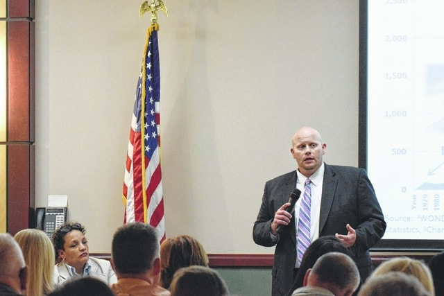 Judge Chad Niese adresses the attendees of Monday night's town hall meeting in Ottowa.