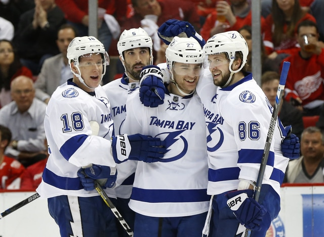 Tampa Bay Lightning right wing Nikita Kucherov, right, celebrates his goal against the Detroit Red Wings with Jonathan Drouin (27), Jason Garrison and Ondrej Palat (18) during the second period of Game 4 in a first-round NHL hockey Stanley Cup playoff series, Tuesday, April 19, 2016, in Detroit. (AP Photo/Paul Sancya)