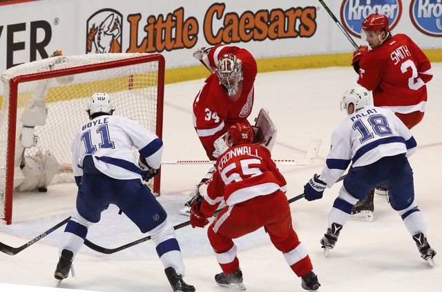 Tampa Bay Lightning left wing Ondrej Palat (18) scores on Detroit Red Wings goalie Petr Mrazek (34) during the third period of Game 4 in a first-round NHL hockey Stanley Cup playoff series, Tuesday, April 19, 2016, in Detroit. (AP Photo/Paul Sancya)