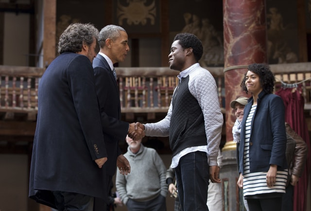President Barack Obama, 2nd left,  greets actors on stage after watching them perform Shakespeare's Hamlet at the Globe Theatre in London, Saturday, April 23, 2016. Obama on Saturday opened his last full day in London by taking in a performance taken from William Shakespeare's play Hamlet, on the 400th anniversary of the playwright's death.  (AP Photo/Carolyn Kaster)