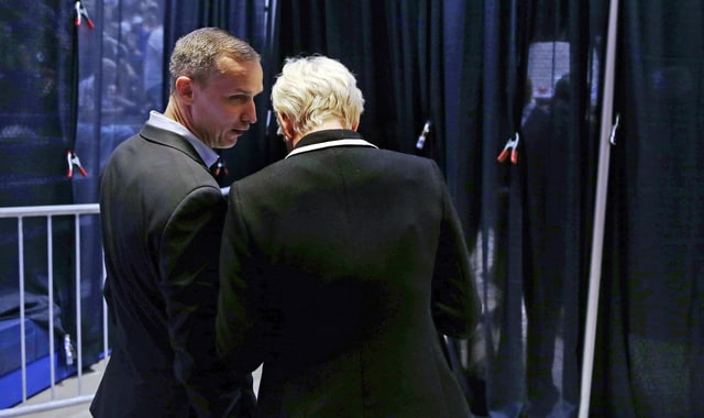 Trumps campaign manager, Corey Lewandowski, left, talks with Trump senior press representative Healy Baumgardner back stage as Republican presidential candidate Donald Trump addresses supporters during a campaign event at Crosby High School in Waterbury, Conn., Saturday, April 23, 2016. (AP Photo/Charles Krupa)