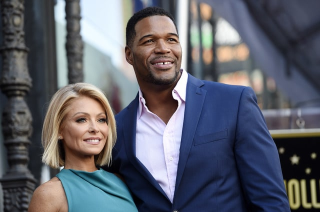 """In this Oct. 12, 2015 file photo, Kelly Ripa, left, poses with Michael Strahan, her co-host on the daily television talk show """"LIVE! with Kelly and Michael,"""" during a ceremony honoring Ripa with a star on the Hollywood Walk of Fame in Los Angeles. Ripa returned as co-host of the morning show after a four-day absence Tuesday. Strahan will leave the show to join """"Good Morning America"""" full-time."""