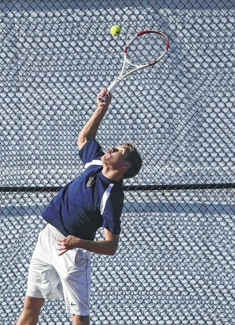 Ottawa-Glandorf's Jordan Verhoff hits a serve during his match against Lima Central Catholic's at the Lima City Tennis Invitational held Saturday at the University of Northwestern Ohio.