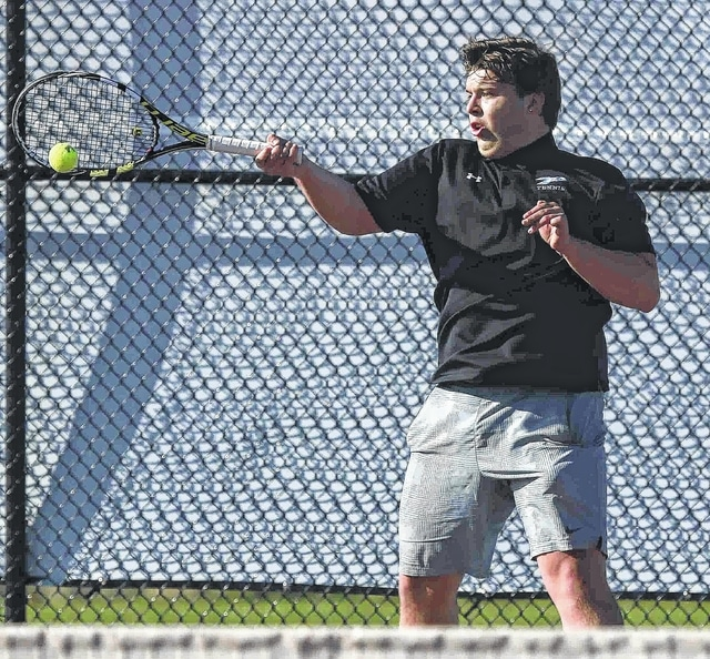 Lima Central Catholic's Spencer Collins returns a shot during his match with Ottawa-Glandorf's Jordan Verhoff at the Lima City Tennis Invitational held Saturday at the University of Northwestern Ohio. See more invitational photos at LimaOhio.com.