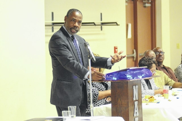 Jonathan Hollingsworth, a Harvard-educated lawyer who grew up in Lima, gives a speech at the NAACP Freedom Fund Banquet on Saturday night at the American Legion Hall in Lima.