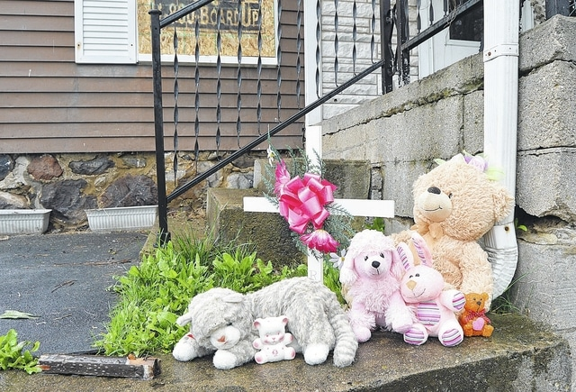 A makeshift memorial has been setup in front of a house located at 519 W. North St. that was the scene of a fatal fire. Firefighters were dispatched to the home at 2:30 a.m. Thursday, April 21. Luke Gronneberg | Sidney Daily News