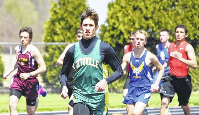 Ottoville's Brendan Siefker gets out in front early in 3,200 at Saturday's Delphos St. John's Invitational. See more invitational photos on 4C and at LimaOhio.com.