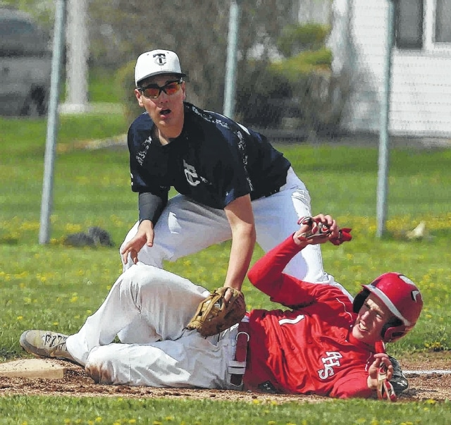 Perry's Dillan Maxwell slides safely into third base as Temple Christian's Joey Hutchison applies the tag during Saturday's doubleheader at Temple Christian.