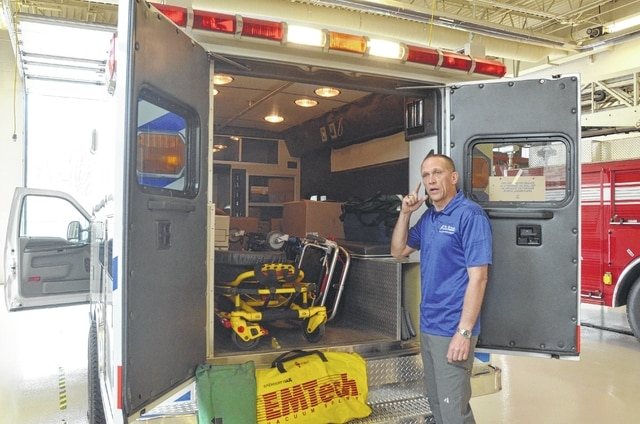 Tim Mosher, a nurse practitioner at St. Rita's, displays the interior of an ambulance he is helping donate to Haiti. The vehicle is being stored at the Bath Township Fire Department until it can be flown to Haiti by the U.S. Air Force.