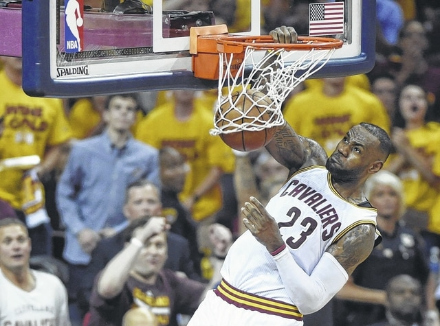 The Cavaliers' LeBron James dunks against Toronto during Wednesday night's playoff game in Cleveland.