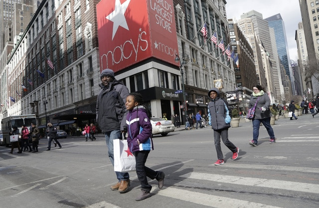 FILE - In this Thursday, Feb. 19, 2015, file photo, Macy's shoppers leave the retailer's flagship store, in New York. Macy's Inc. reports financial results Wednesday, May 11, 2016. (AP Photo/Mark Lennihan, File)