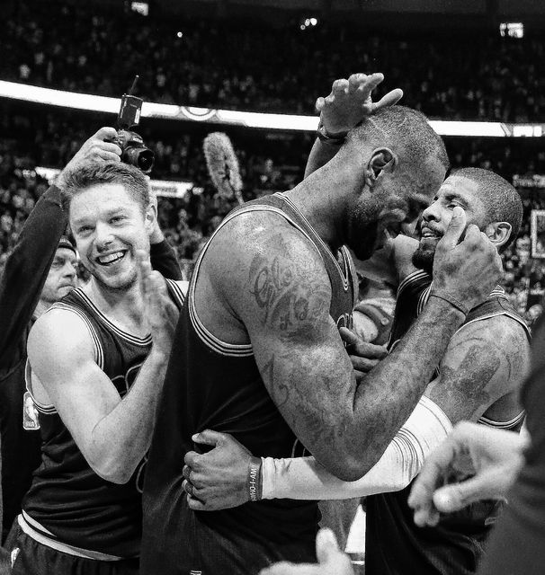 LeBron James (23) celebrates with Kyrie Irving, right, and Matthew Dellavedova (8) after Game 4 of the second-round NBA basketball playoff series against the Atlanta Hawks on Sunday. (AP Photo)