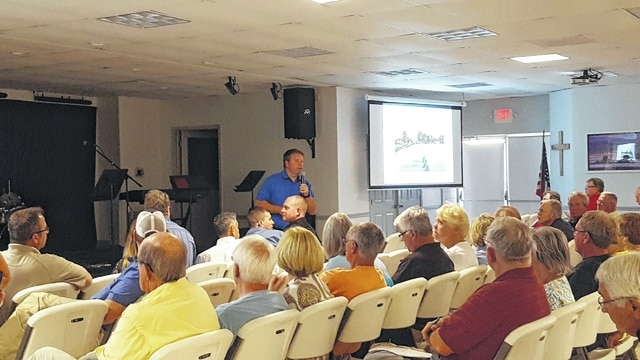 Residents near Indian Lake received an update from state officials about a plan to repair the Indian Lake damn during a meeting Wednesday evening at the Indian Lake Community Church Lighthouse in Russells Point. The construction on the $8 million project is expected to begin after Labor Day and be completed by fall 2017.