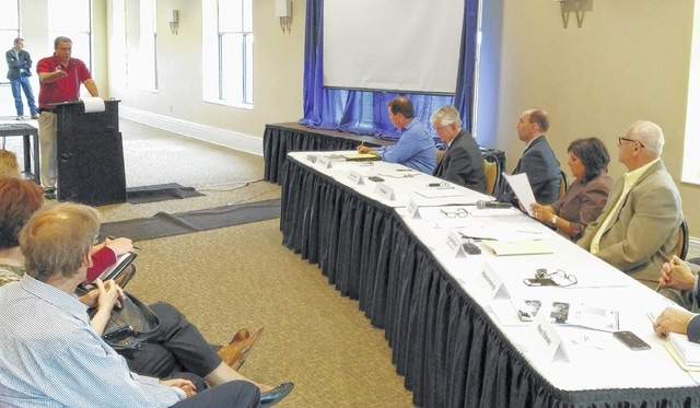 Amanda Township Trustee Brad Core testified to the Port Authority of Allen County about his concerns with a proposed wind energy transmission line Thursday at the City Club.