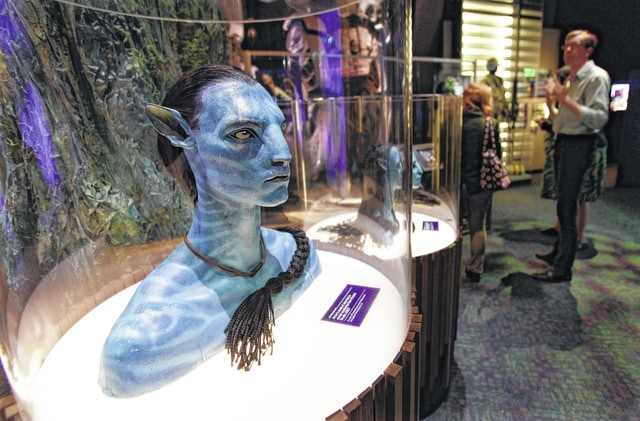 """A figure of Jake Sully's avatar character from the movie """"Avatar,"""" is on display at the Experience Music Project in Seattle in 2011. Before moviegoers return to Pandora, they'll be able visit the exotic alien world from """"Avatar"""" on their smartphones."""
