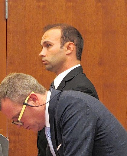 Former Ohio State University drum major instructor Stewart Kitchen, background, stands next to defense attorney Thomas Hayes in a Franklin County courtroom while being sentenced to three years in prison for sexual battery on Wednesday in Columbus. Kitchen, who was accused of raping a female student, pleaded guilty to sexual battery and apologized to the victim in court.