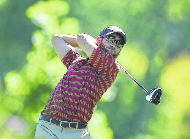 Ian Haidle watches his tee shot on the seventh hole Saturday during the Lima City Men's Golf Championship at Shawnee Country Club.
