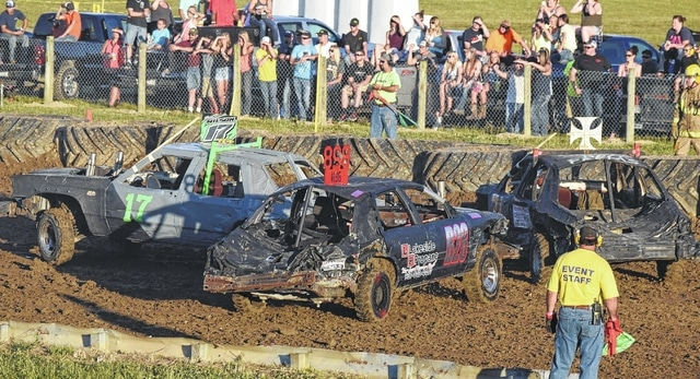 Brian Wilson, No. 17, smashes into a car using the rear bumper to protect his engine. Wilson was the winner of the demolition derby at the Putnam County Fair.