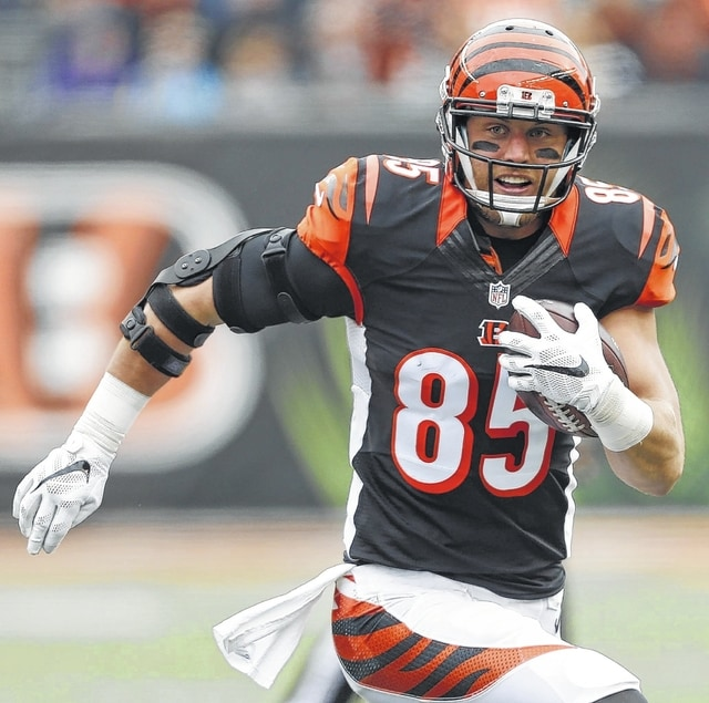 Cincinnati tight end Tyler Eifert has to wear a protective boot for at least another week.
