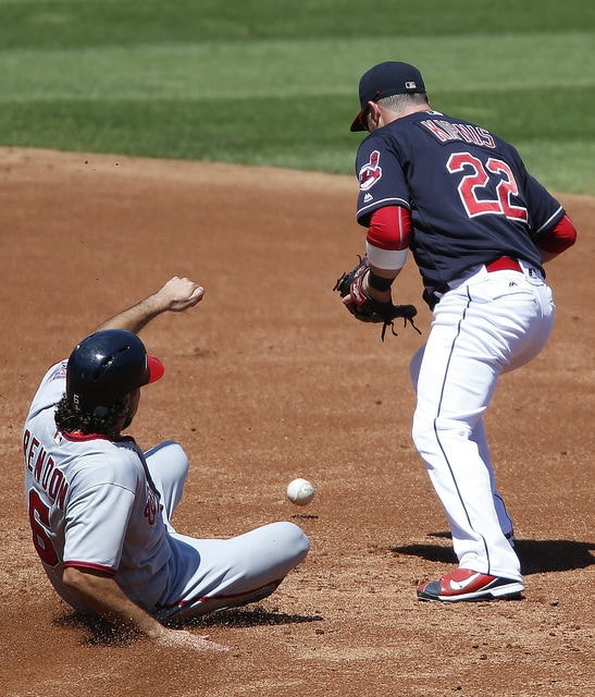Cleveland Indians' Jason Kipnis (22) bobbles the exchange after forcing out Washington Nationals' Anthony Rendon (6) at second base, preventing him from turning the double play during the first inning of a baseball game Wednesday, July 27, 2016, in Cleveland. (AP Photo/Ron Schwane)