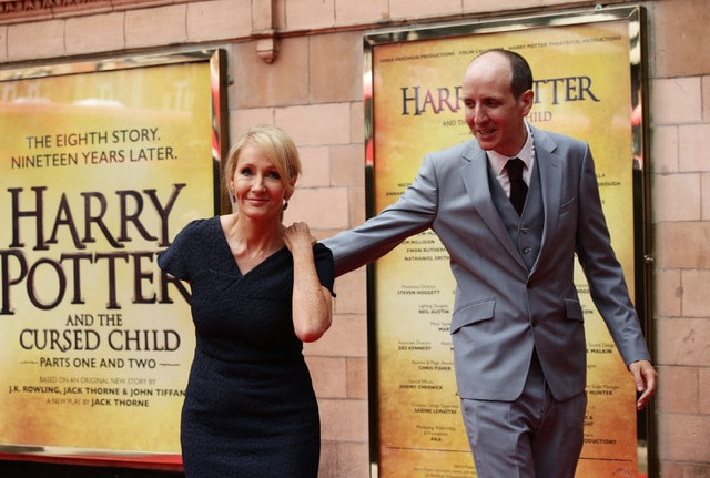 Writers J.K. Rowling, left, and Jack Thorne pose for photographers upon arrival at gala performance of Harry Potter and the Cursed Child, at the Palace Theatre in central London, Saturday, July 30, 2016. Based on an original new story by J.K. Rowling, John Tiffany and Jack Thorne, it is the eighth story in the Harry Potter series and is the first of the stories to be presented on stage. (Yui Mok/PA via AP)
